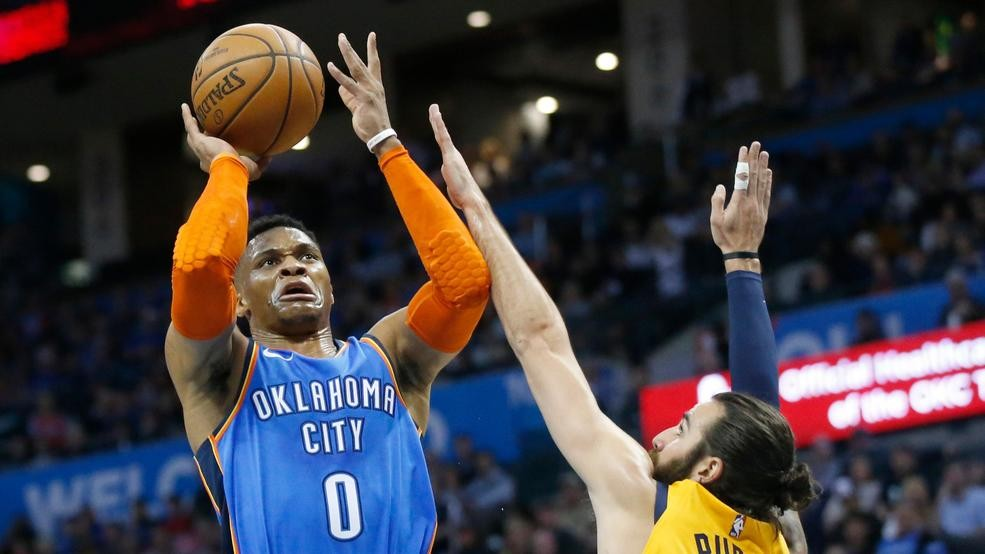 567c63f74dc Oklahoma City Thunder s Russell Westbrook (0) shoots as Utah Jazz guard  Ricky Rubio (3) defends in the first half of an NBA basketball game in Oklahoma  City ...