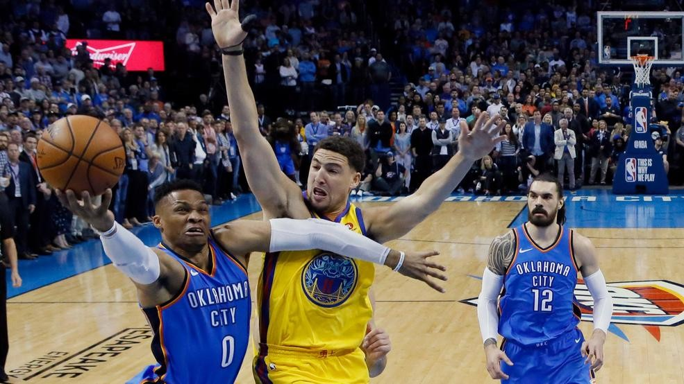 6feb3764aedd Oklahoma City Thunder guard Russell Westbrook (0) goes to the basket in  front of Golden State Warriors guard Klay Thompson