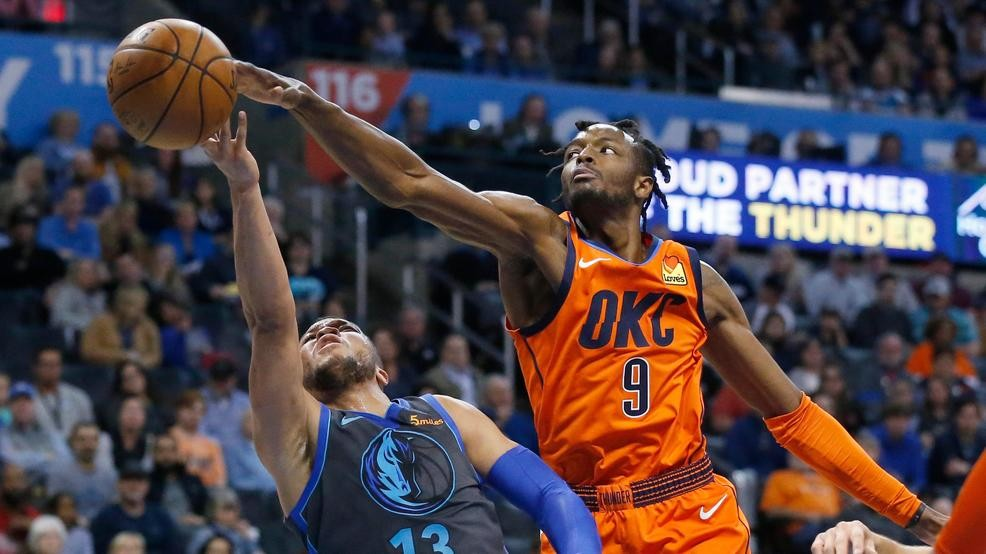 1aa1244648b Oklahoma City Thunder forward Jerami Grant (9) reaches in to block a shot  by Dallas Mavericks guard Jalen Brunson (13) in the first half of an NBA ...